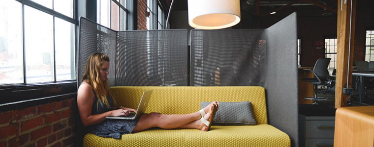 woman-working-on-couch
